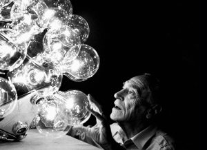 Achille Castiglioni Italian designer with the Taraxacum pendant light.